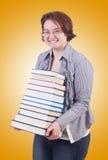 Flickastudent med böcker på vit Royaltyfri Bild
