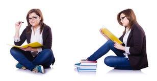 Flickastudenten med böcker på vit Royaltyfri Fotografi