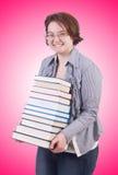 Flickastudenten med böcker på vit Arkivfoton