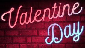 Flickering blinking red and blue neon sign on red love brick wall background, valentine day holiday event festive sign. Flickering blinking red and blue neon Stock Photos