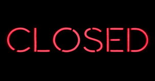 Flickering blinking red neon sign on black background, closed restaurant shop bar sign stock footage