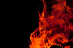 Flickering Flames. Flames against a black background Royalty Free Stock Photos
