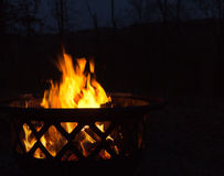 Flickering flames in a fire pit Royalty Free Stock Photos