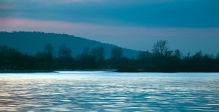 Flickering surface of the river at sunset in the early winter stock image