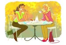 Flickor i kafé Fotografering för Bildbyråer