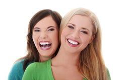 flickor lyckliga två Fotografering för Bildbyråer