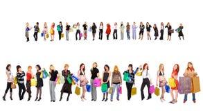 flickor många shopping Arkivfoto