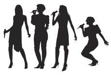 Flickor med mikrofonen Arkivfoto
