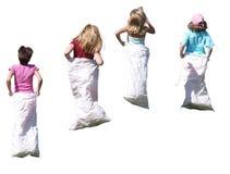 flickor race säcken Royaltyfri Foto