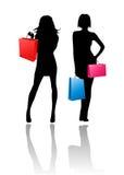 flickor som shoppar silhouetten Arkivbild