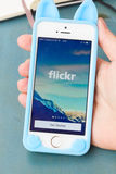 Flickr on page of new Iphone 5s. PUERTO CRUZ, SPAIN - JULY 06, 2014: Flickr page on new iphone 5s. The photo-sharing social network, the service is widely used Royalty Free Stock Image