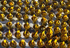 Flickring butter lamps. Butter Lamps outside Swayambhunath stupa, Kathmandu, Nepal stock photography