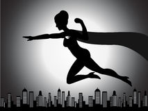 Fliegen-Superheld-Mädchen-Schattenbild Lizenzfreie Stockbilder