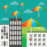 Fliegende farbige Regenschirme Stockfotografie