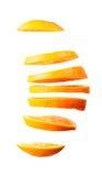 Fliegende orange Scheiben Stockbild