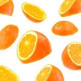 Fliegende orange Scheiben lokalisiert auf weißem Hintergrund Stockfotografie