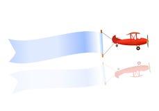 Fliegende unbelegte Fahne und Flugzeug Stockfotos