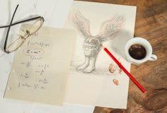 Fliegender Magnetkopf mit einem Tasse Kaffee Stockfotografie