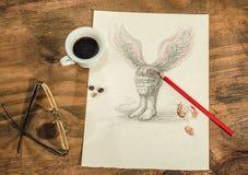 Fliegender Magnetkopf mit einem Tasse Kaffee Stockbilder