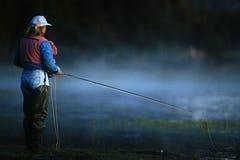 Fliegenfischenfrau 01 Stockfotos