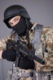 FLIEGENKLATSCHE Kommandant mit Maschinengewehr stockfotografie