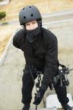 Fliegenklatsche Team Officer Rappelling Lizenzfreies Stockfoto