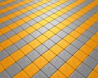 Fliehen des gelben und grauen Mosaiks Stockfotografie