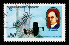 Flies around Statue of Liberty 1908 and W. Wright portrait, circa 1979. MOSCOW, RUSSIA - AUGUST 29, 2017: A stamp printed in Equatorial Guinea shows Flies around Royalty Free Stock Photos