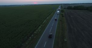 Cargo truck moving aerial. Flies following car cargo truck moving countryside road stock video