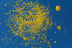 Flies in the sky yellow balls Royalty Free Stock Photography