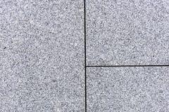 Fliesen oder Platten der grauen und körnigen Granit- oder Marmorbeschaffenheit lizenzfreie stockfotografie