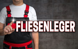 Fliesenleger (in german tiler) touchscreen is shown by craftsman Royalty Free Stock Photography