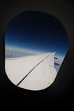 Flight. Airplane wing seen through the window Stock Photography