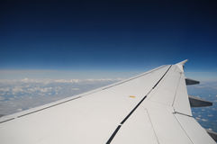 Flight. An airplane wing during flight Stock Image