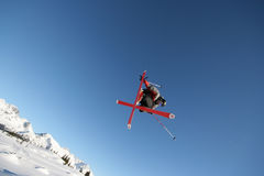 In Flight. A skier shows off his moves in Whistler, BC royalty free stock photography