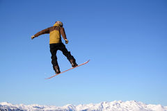 Flight. A snowboarder flies through the air with ease in Whistler, BC royalty free stock photos