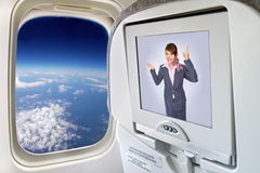 The flight. Monitor and a window on the plane Royalty Free Stock Image