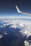 In flight. Earth and sea during flight royalty free stock photography