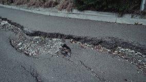 Flight above a big crack on the asphalt. A flight above a big crack on the asphalt stock video footage
