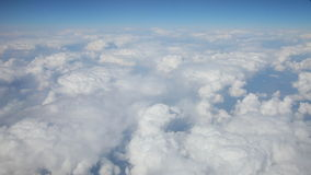 Flight above clouds. Blue sky view from flight above clouds. Video clip filmed from plane