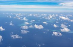 Flight above clouds and indian ocean Royalty Free Stock Photo