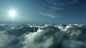 Flight above clouds at sunset, stock footage Stock Photo