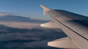 Flight above the Clouds. View of airplane wing above the clouds stock video footage