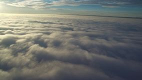 Flight above clouds stock footage