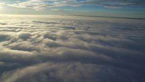 Flight above clouds stock video