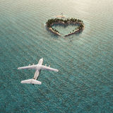 Flight above Heart-shaped island Royalty Free Stock Images