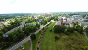 Flight above the houses and roads. City traffic. Aerial view stock footage