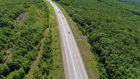 Flight above road with cars stock video footage