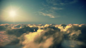 Flight above timelapse clouds at sunset, stock footage Royalty Free Stock Photo