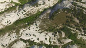 Flight above white rocky mountains with plateaus and canyons, aerial video stock video